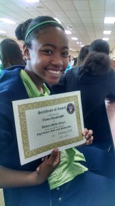 "Elena with her ""High Honor Roll with Distinction"" awards."
